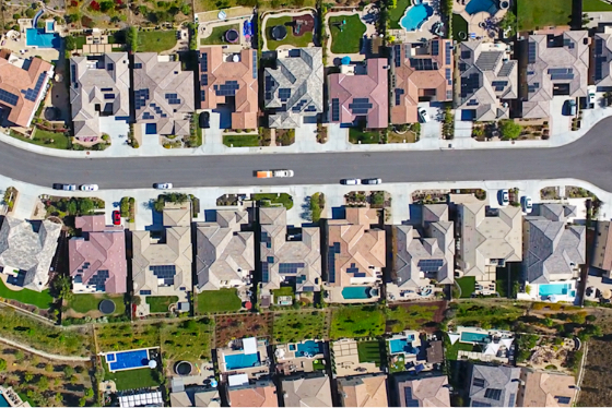 Aerial view of homes with solar